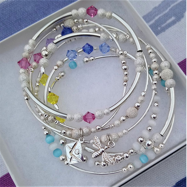 Sterling silver stacking bracelet collection