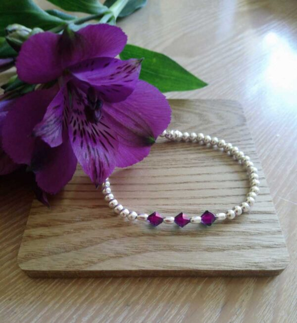 February birthstone bracelet - silver beads and amethyst crystals