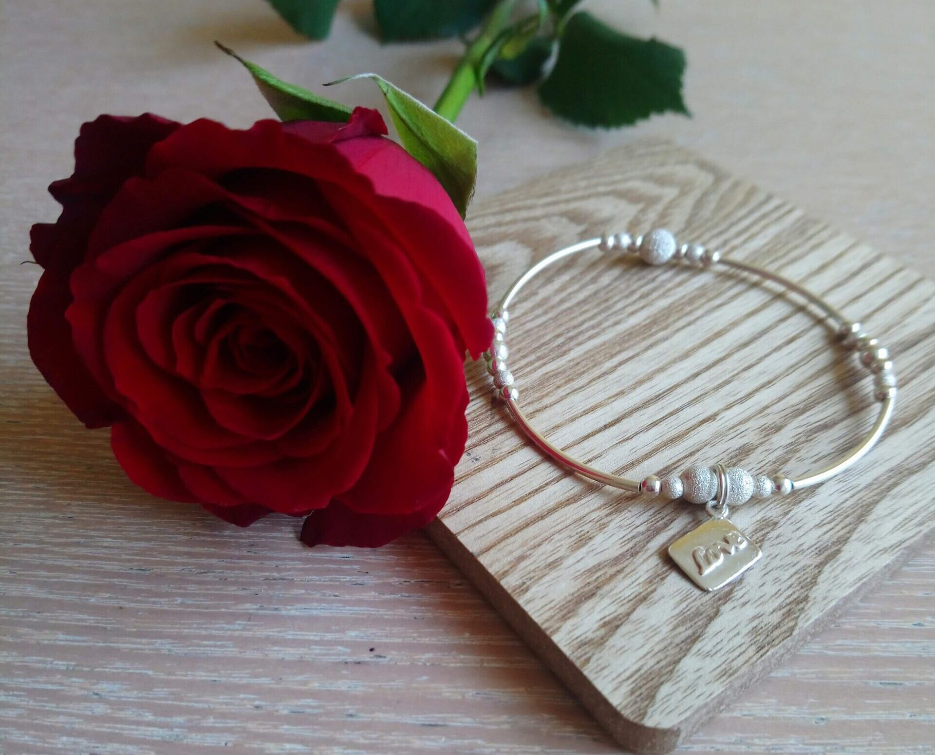 red rose and silver love charm bracelet